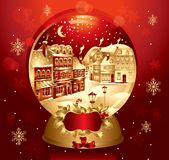 Golden christmas snow globe Stock Images