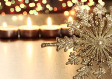 Golden Christmas snowflake and candles Stock Photos