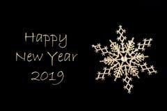 Golden Christmas snowflake close-up on black background. Xmas decoration. royalty free stock photos