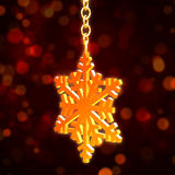 Golden Christmas snowflake over red background Stock Photos