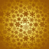 Golden Christmas snowflakes background Royalty Free Stock Photography
