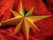 Golden Christmas star. Waiting to be placed in the top of tree stock photography