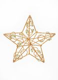 Golden christmas star. Isolated against white background, with glass beads Royalty Free Stock Photography