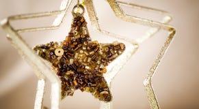 Golden Christmas star. Beautiful golden Christmas star hanging stock photo