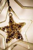 Golden Christmas star. Beautiful golden Christmas star hanging stock photos