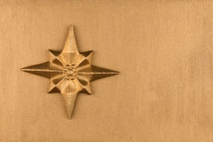 Golden Christmas star on gold background. View from above. Closeup royalty free stock images