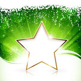 Golden Christmas star on green background Royalty Free Stock Photography