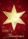 Golden Christmas Star on Red Bokeh Background Stock Photography