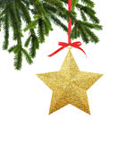 Golden Christmas star on red ribbon on green new year tree. Isolated on white background royalty free stock photo