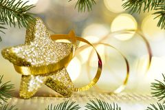 Golden Christmas Star with Ribbon. And Needles royalty free stock photos