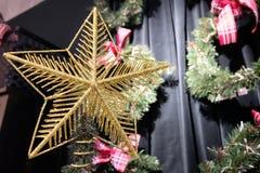 Golden Christmas star on Christmas tree. Golden Christmas star on Christmas tree stock images