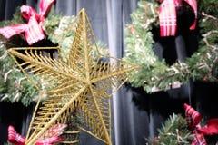 Golden Christmas star on Christmas tree. Golden Christmas star on Christmas tree stock photo