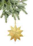Golden Christmas star on tree branch isolated on white. Background stock photography
