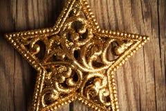 Golden christmas star Stock Photos