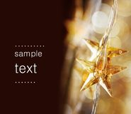 Golden Christmas stars. With very shallow focus royalty free stock image