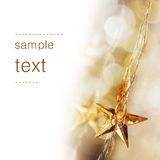 Golden Christmas stars. With very shallow focus royalty free stock photo
