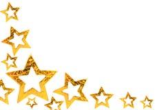 Golden Christmas stars Stock Images