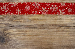 Golden christmas stars on red fabric. Wooden blank board for your christmas greetings Stock Photos