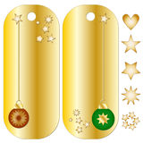 Golden Christmas tags with baubles and stars Stock Photos
