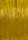 Golden Christmas tinsel background royalty free stock photography