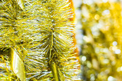 Golden Christmas tinsel with a ribbons Royalty Free Stock Photography