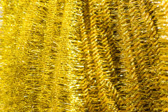 Golden Christmas tinsel Stock Photo