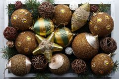 Golden christmas toys in white wooden box Stock Photography