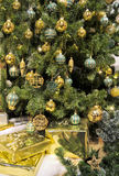 Golden Christmas Tree. Christmas Tree and Packages with golden Decoration Royalty Free Stock Images
