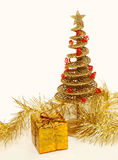 Golden Christmas tree . Golden Christmas tree with a box Royalty Free Stock Photography