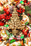 Golden christmas tree with baubles, toys and ornaments Stock Photos