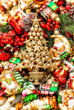 Golden christmas tree with baubles, toys and ornaments Stock Photography