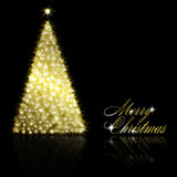 Golden Christmas  tree on black background Royalty Free Stock Image