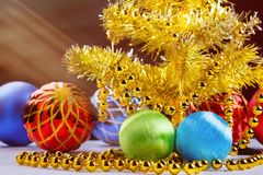 Golden christmas tree with decorated balls and light beams on dark background. Royalty Free Stock Photography