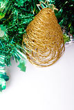 Golden Christmas tree decoration. On a shiny green background Stock Photo