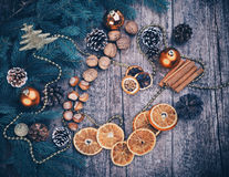 Golden Christmas Tree Decoration,  Cinnamon Sticks, Dried Oranges, Baubles. Royalty Free Stock Photography