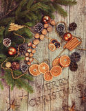 Golden Christmas Tree Decoration,  Cinnamon Sticks, Dried Oranges, Baubles. Stock Photo