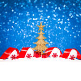 Golden Christmas tree on glitter blue background Royalty Free Stock Photos