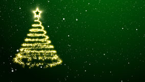 Golden Christmas tree on a green background Stock Photos