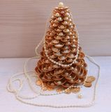 Golden Christmas Tree handmade from seashells on a white background Stock Photography