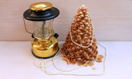 Golden Christmas Tree handmade from seashells on a white background Stock Images