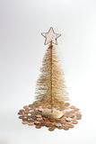 Golden Christmas tree on money. royalty free stock image