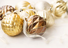 Golden Christmas tree ornaments with delicate balls and ribbon Stock Image