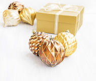 Golden Christmas tree ornaments with pearly balls decoration and Royalty Free Stock Images
