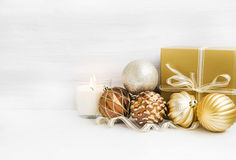 Golden Christmas tree ornaments with pearly balls decoration and Stock Photos