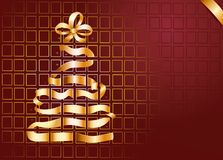 Golden Christmas tree on red background Stock Image