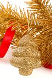 Golden christmas tree toy. On golden fir-tree branch Royalty Free Stock Photos