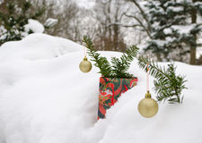 Golden christmas tree toys yew branch winter snow Stock Photos