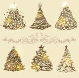 Golden Christmas trees. Stock Photo