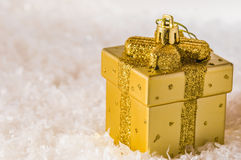 Golden chtistmas decoration. Golden Christmas decoration on artificial snow Stock Photography