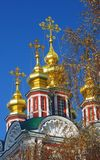 Golden church cupolas and crosses. Blue sky background. Royalty Free Stock Photos